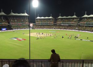 Cricket pitch with stands in the background