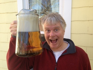 Man holding a very large beer